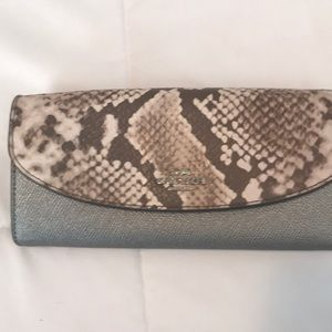 Perfect condition Coach animal print wallet.